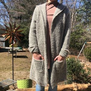 Fuzzy long hooded sweater with pockets